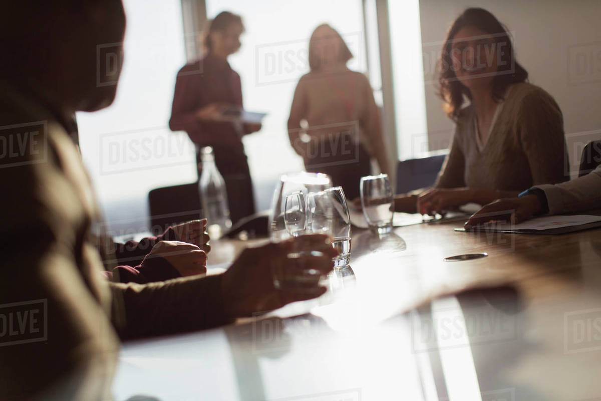 Business people talking in sunny conference room meeting Royalty-free stock photo