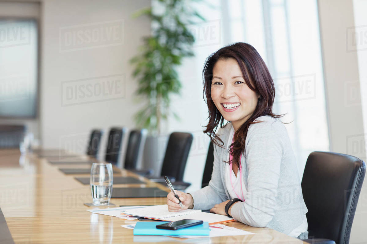 Portrait confident smiling businesswoman working in conference room Royalty-free stock photo