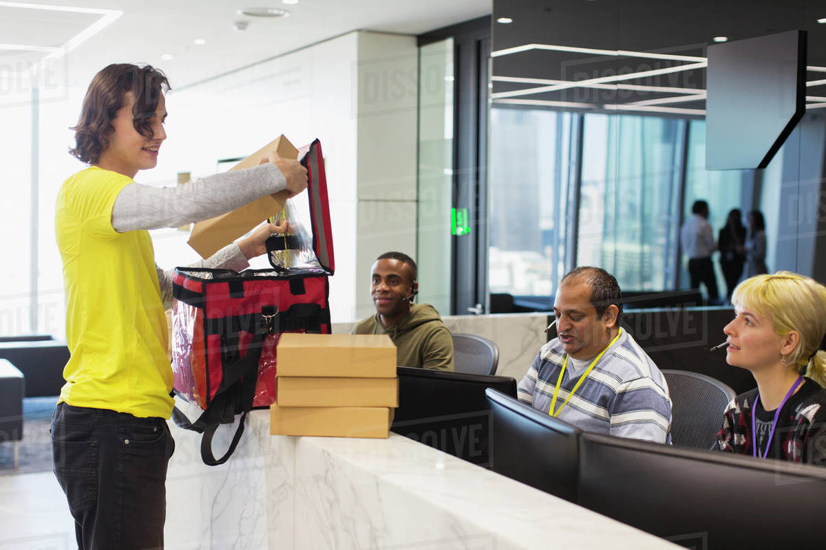 Messenger delivering lunch to business office Royalty-free stock photo