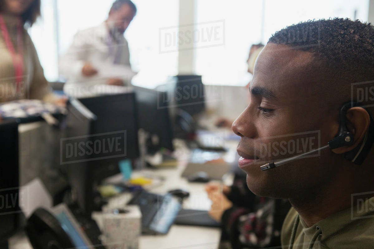 Businessman with headset working in office Royalty-free stock photo