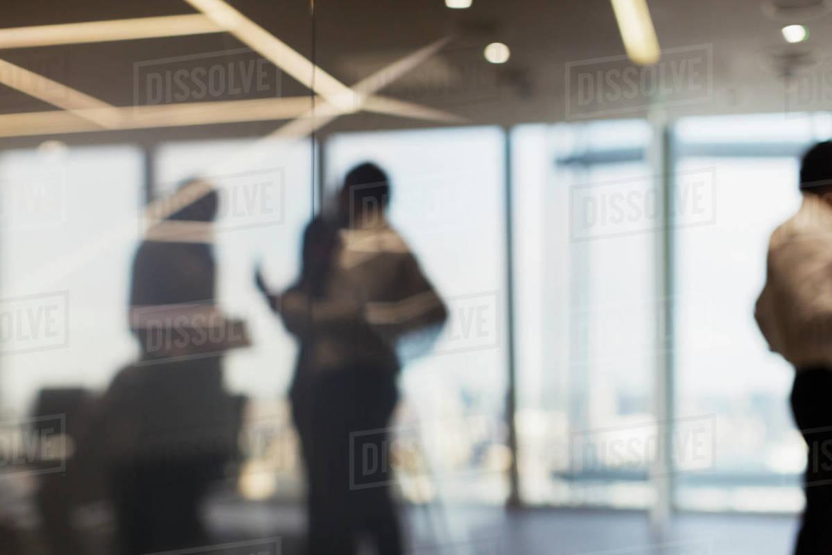 Defocused business people talking in office Royalty-free stock photo