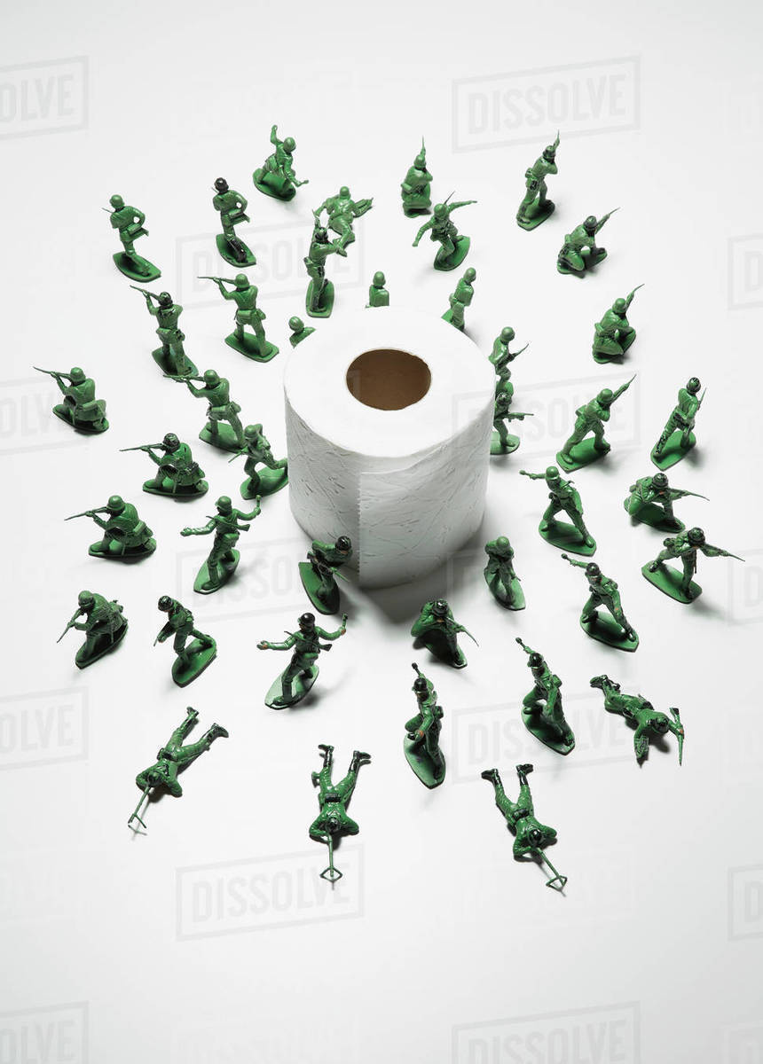Toy soldiers guarding toilet paper during COVID-19 pandemic Royalty-free stock photo