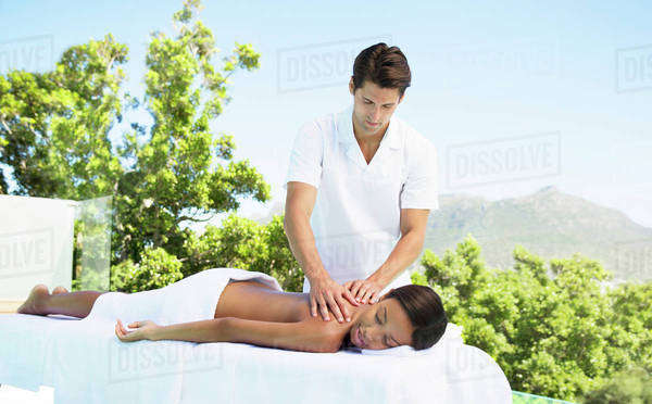 Woman receiving massage on patio at spa Royalty-free stock photo