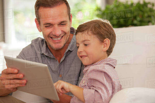 Father and son using digital tablet Royalty-free stock photo