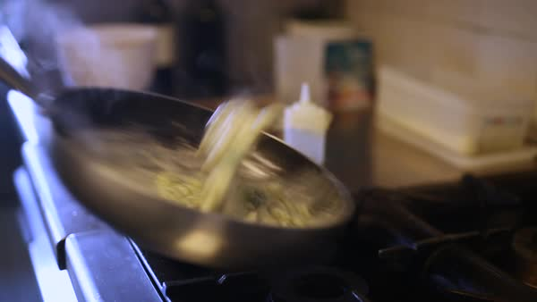 Medium shot of a person making food in pan Royalty-free stock video