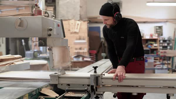 Medium shot of a man using a table saw Royalty-free stock video