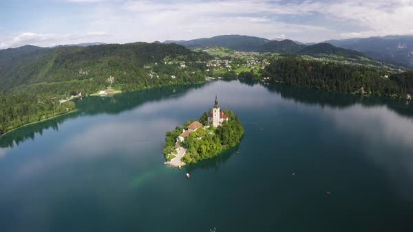 Aerial shot of old church in the middle of Bled lake Royalty-free stock video