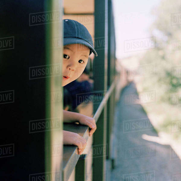 An excited boy leaning out of a train window Royalty-free stock photo