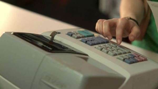 Close-up, Lockdown, High Angle View, A human hand working a cash register and receiving money Royalty-free stock video