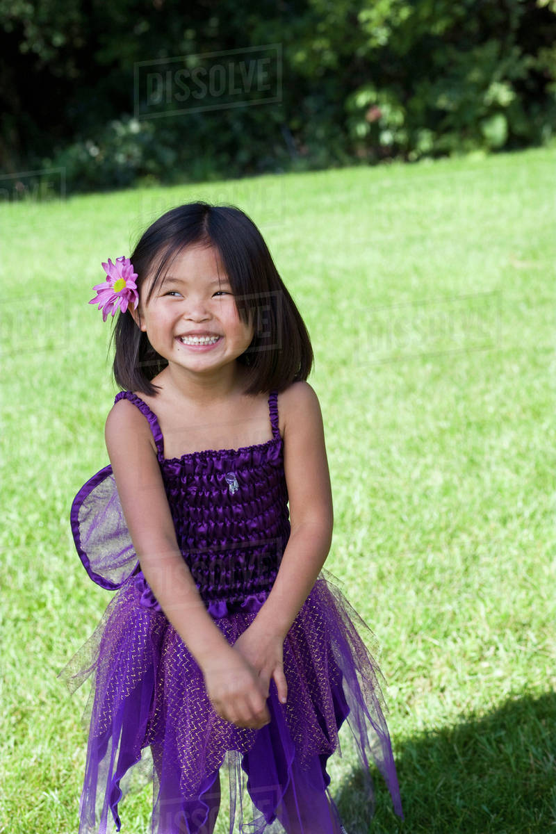 A young girl in a fairy costume standing in a back yard Royalty-free stock photo