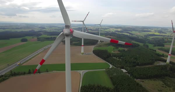 Aerial drone shot of windmills turning on field against sky, Bayreuth, Bayern, Germany Royalty-free stock video