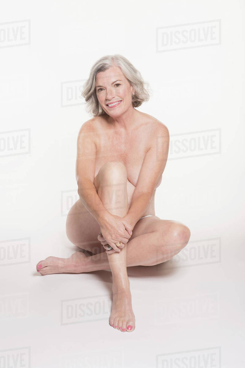 Full Length Portrait Of Naked Mature Woman Sitting Against -9057