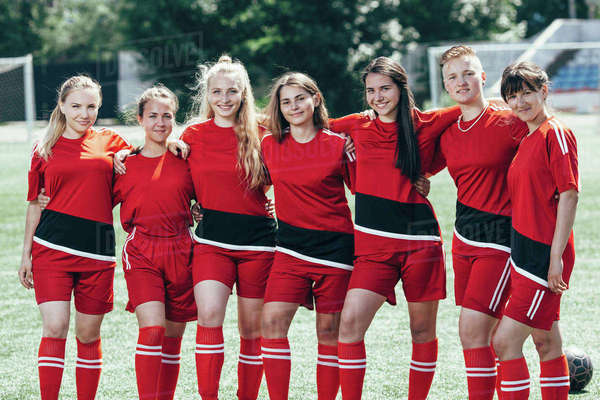 Portrait of smiling soccer players standing on field Royalty-free stock photo