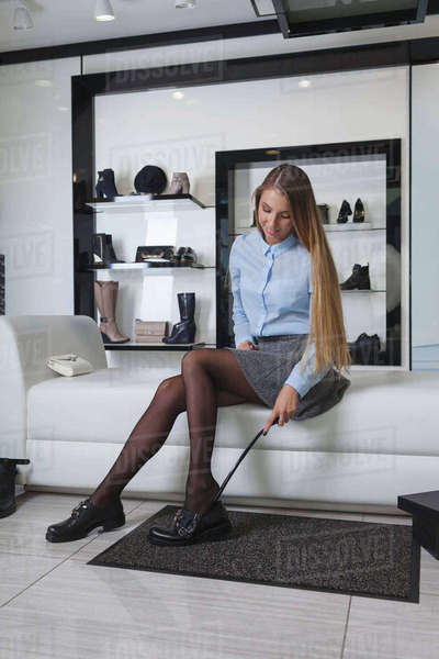 Young woman trying on shoes at store Royalty-free stock photo