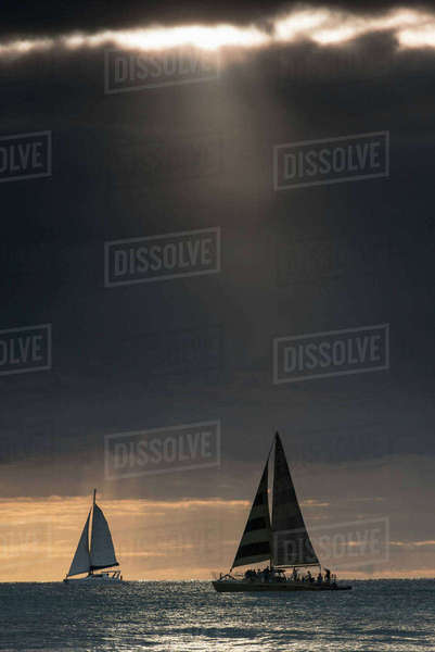 Boats sailing in sea against dramatic sky Royalty-free stock photo