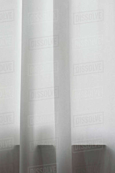 Detail of white curtain in front of window Royalty-free stock photo