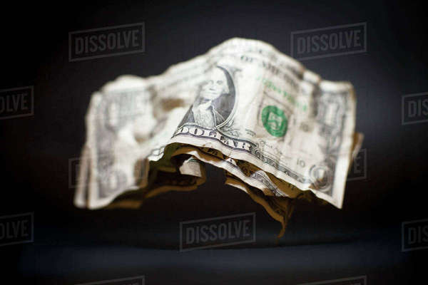 Close-up of crumpled old American one dollar bills levitating against black background Royalty-free stock photo