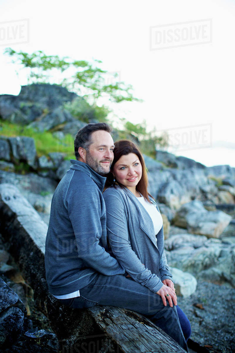 Happy, affectionate couple relaxing on beach Royalty-free stock photo