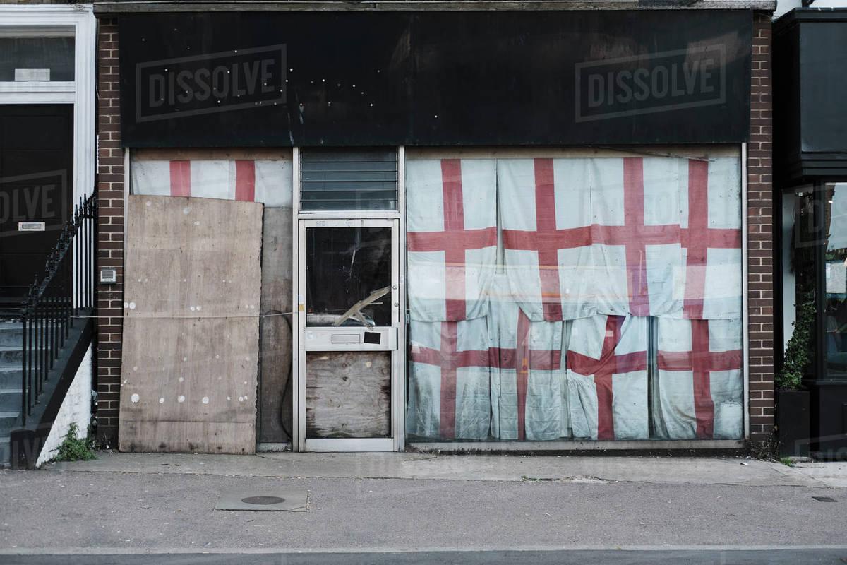 English flags covering abandoned storefront, Margate, England Royalty-free stock photo
