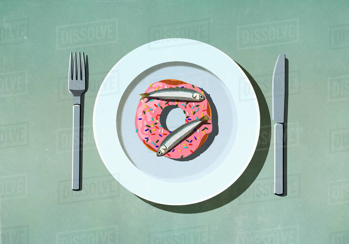 Sardines on top of donut on plate Royalty-free stock photo