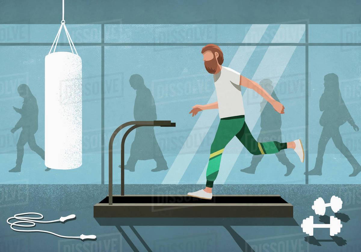 Business people walking behind man running on treadmill Royalty-free stock photo