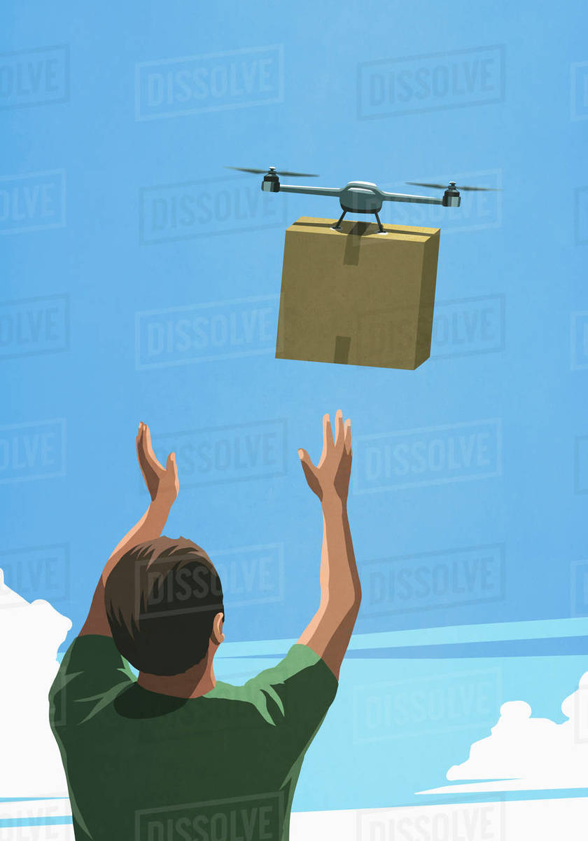 Man releasing drone with cardboard box delivery Royalty-free stock photo