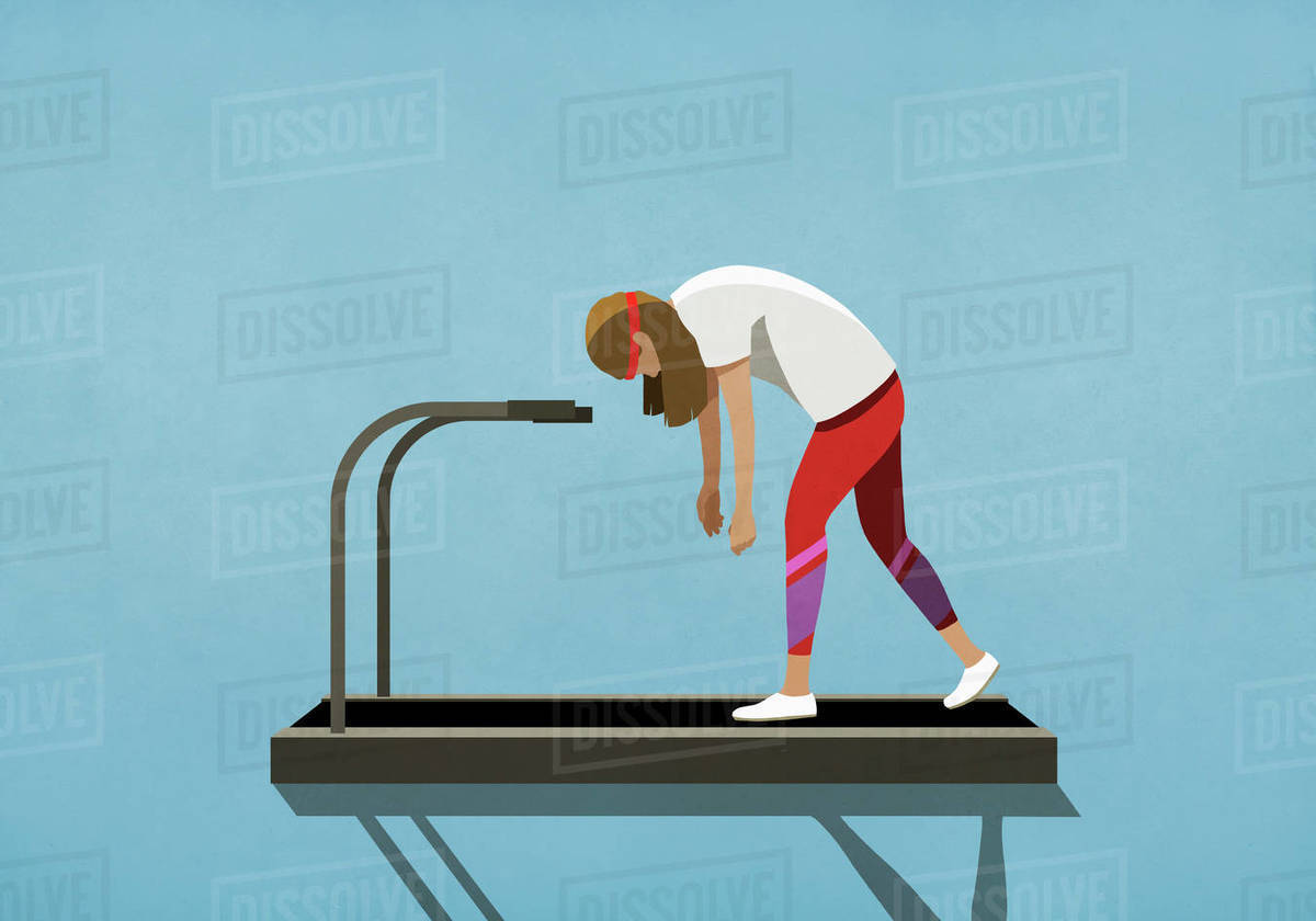Tired woman walking on treadmill Royalty-free stock photo