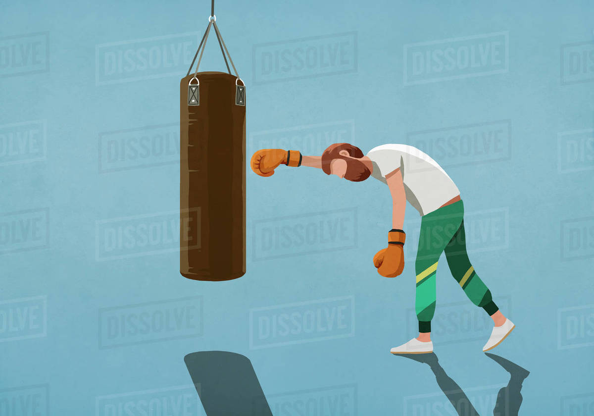 Tired man boxing at punching bag Royalty-free stock photo