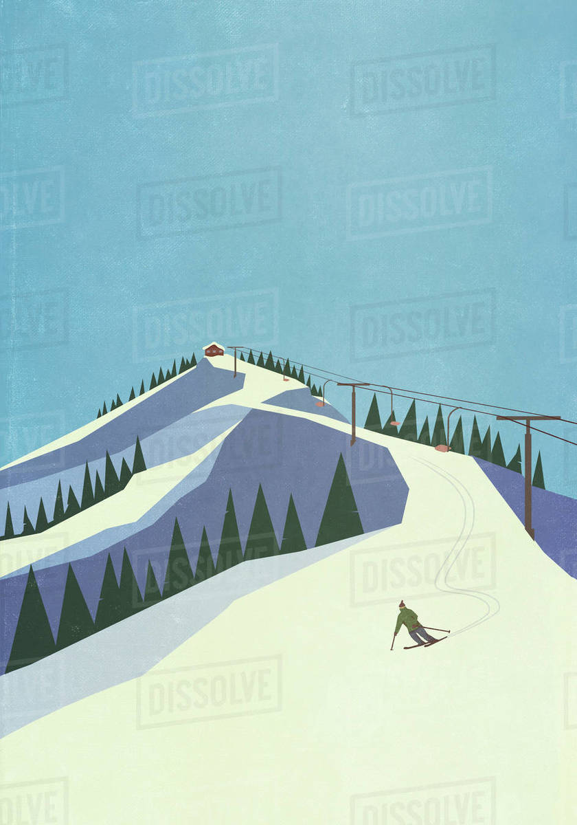 Skier descending snowy mountain slope Royalty-free stock photo