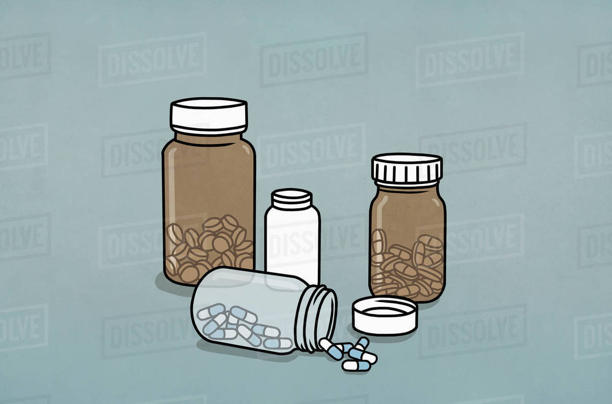 Pills in medicine bottles Royalty-free stock photo