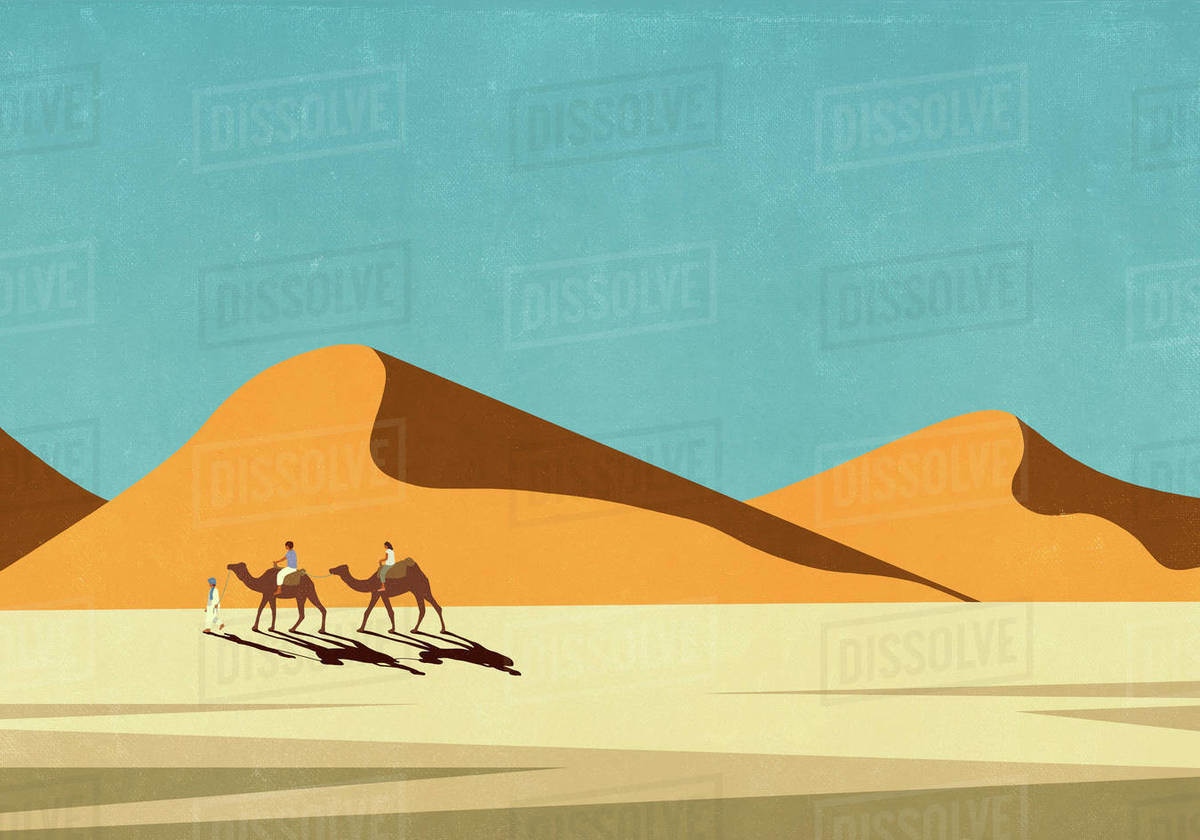 Tourists riding camels in sunny, remote desert landscape Royalty-free stock photo