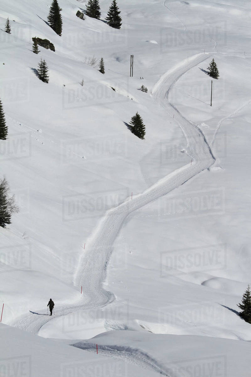Cross country skier on snow covered mountain path, Vals, Canton of Grisons, Switzerland Royalty-free stock photo