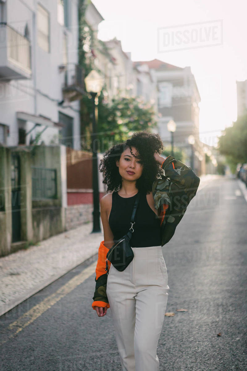 Portrait confident, stylish young woman in urban street Royalty-free stock photo