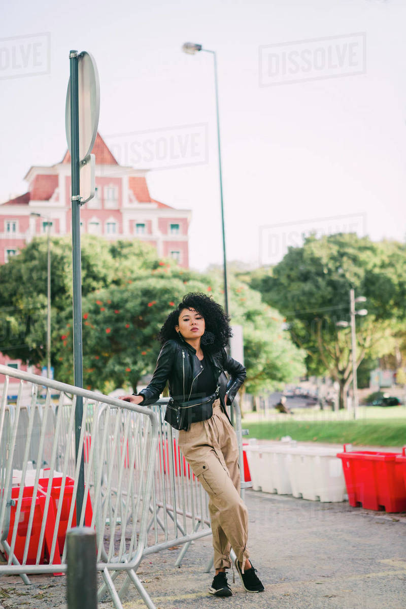 Portrait confident, stylish young woman in city park Royalty-free stock photo
