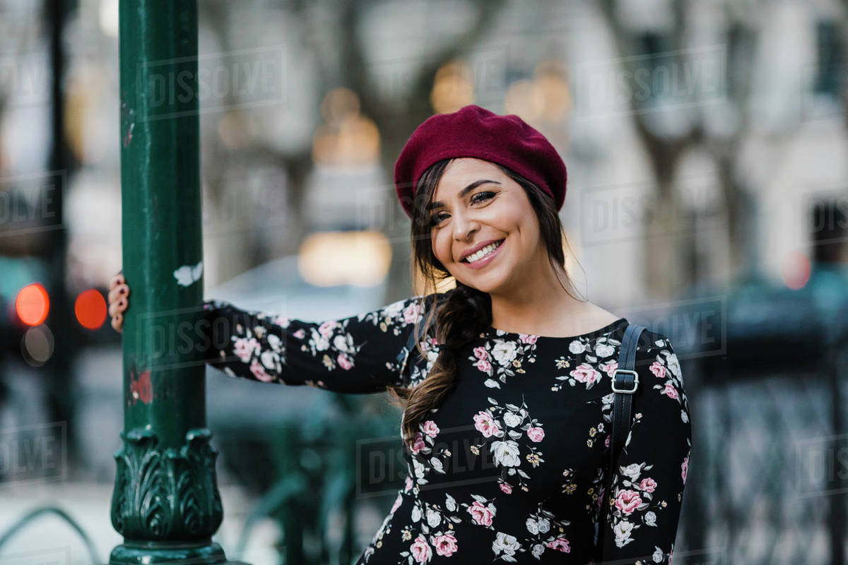 Portrait carefree young woman in beret Royalty-free stock photo