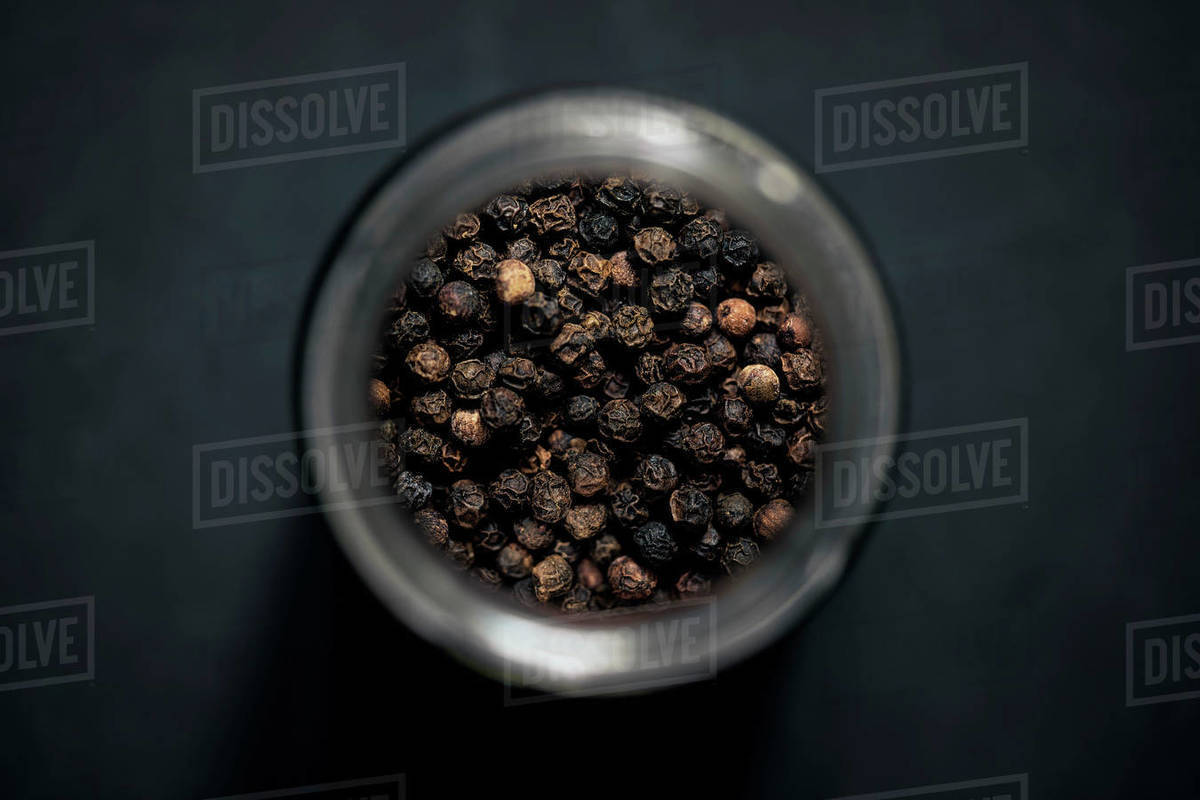 View from above black peppercorns in spice jar Royalty-free stock photo