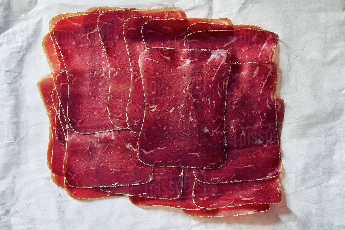 View from above sliced, air-dried Buendnerfleisch meat on butcher paper Royalty-free stock photo