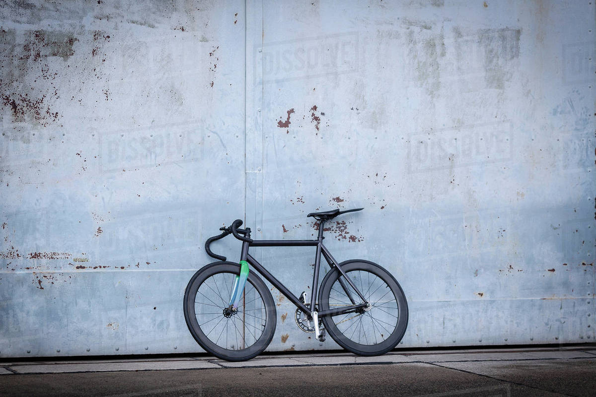 Racing bicycle leaning against concrete wall Royalty-free stock photo