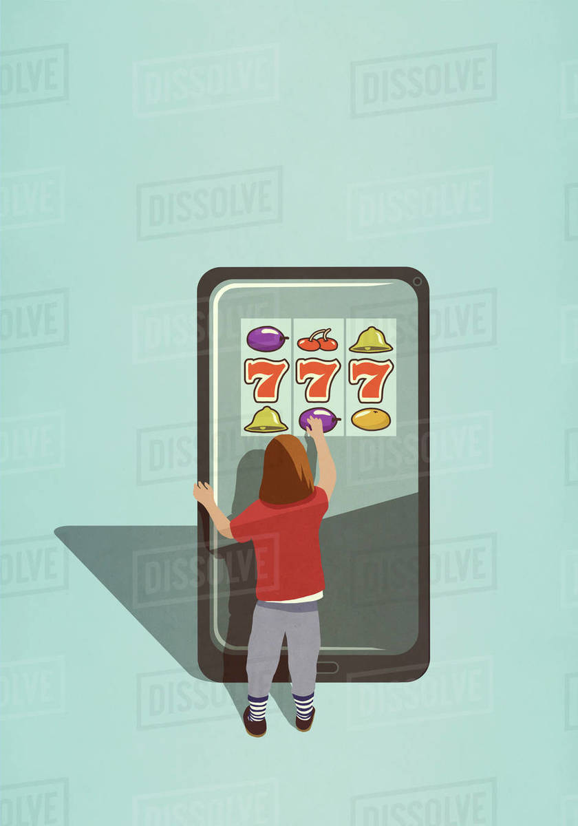 Girl playing slot machine game on large smart phone Royalty-free stock photo