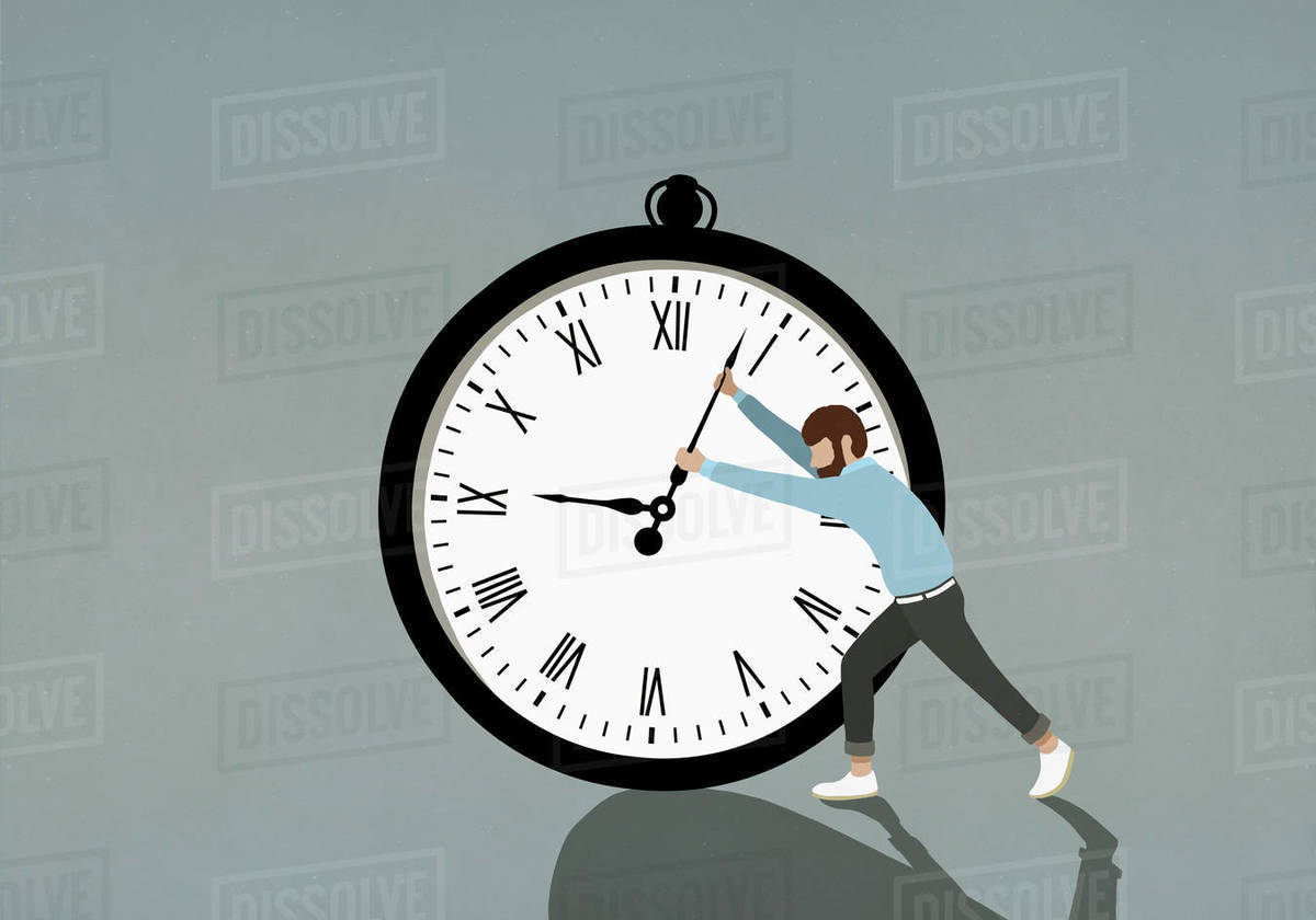 Man pushing hands of large stopwatch Royalty-free stock photo