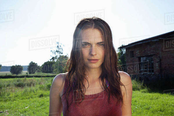 Profile of girl in field with barn in background Royalty-free stock photo