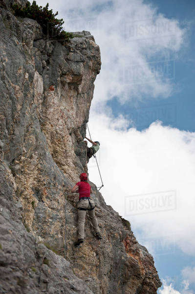 Two people climbing rock face at The Wetterstein, Tirol, Austria, Royalty-free stock photo
